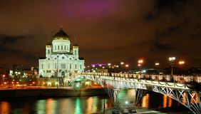 Cathedral Of Christ The Savior, Moscow, Russia. View of the Cathedral of Christ the Saviour in Moscow and a bridge over the Moscow river. Russia. Filmed at night Stock Photos