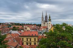 View of cathedral and churches towers over the rooftops in Zagreb, Croatia. View of the cathedral and churches towers over the red rooftops in old upper town of royalty free stock photos