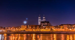 View of Cathedral of Magdeburg and the river Elbe at night with Royalty Free Stock Photography