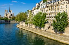 View of the cathedral of Notre Dame and the river Seine royalty free stock images
