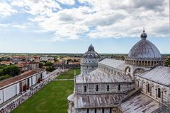View of the Cathedral of Pisa from the top of the Famous Leaning Tower in the city of Pisa, Italy royalty free stock image