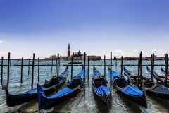 A view of the Cathedral of San Giorgio Maggiore, Venice lagoon and gondolas from the Piazza San Marco, Venice Royalty Free Stock Photo