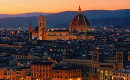 Sunset view of Florence, Palazzo Vecchio and Florence Duomo, Italy. Architecture and landmark of Florence. Night cityscape of Flo royalty free stock photos