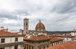 View of the Cathedral of Santa Maria - Del - Fiore and the Giotto`s bell tower from the rooftops in Florence, Italy stock photo