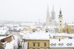 A view of the cathedral of Zagreb, Croatia, and roofs covered in. A view of the cathedral of Zagreb, Croatia, and picturesque roofs covered in snow Stock Photos