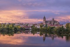 View of the cathedrals of Salamanca at sunset in the river, Spain Royalty Free Stock Images