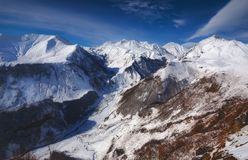 View of Caucasian Mountain in winter. Cross Pass in Georgia. Gudauri District. Source of Aragvi River royalty free stock images
