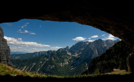 View from a cave. View on a mountains from a cave Royalty Free Stock Photos