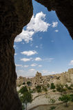 A view of a cave city in Cappadocia, Turkey. A landscape of a cave city in Cappadocia, Turkey from between the rocks with clouds Stock Photos