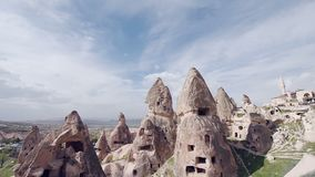 View of cave houses in rock formation at Ortahisar. Cappadocia. Nevsehir Province. Turkey. View of cave houses in rock formation at Ortahisar. Cappadocia, with stock video
