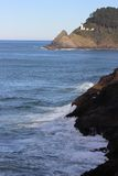 View from a cave looking out onto Lighthouse. Oregon coast Florence looking out over lighthouse from Sea Lion Caves Stock Images