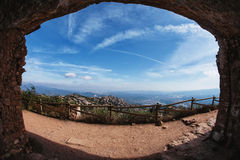 View from a cave on the mountain path. Mountains and sky Royalty Free Stock Photos