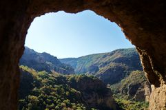 View from the cave to the green mountain valley! royalty free stock photo