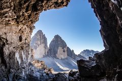 View from a cave on two of the three peaks / Tre Cime. View from a cave on two of the three peaks in the Tre Cime Nationalpark in the European Alps, Italy royalty free stock images