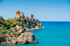 View of Cefalu with beach and castle Stock Photo