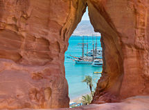 View on central beach of Eilat through stone arch, Israel Royalty Free Stock Images