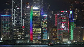 View of central Hong Kong. Hong Kong Special Administrative Region of the People's Republic of China - April 19, 2016: city glowing at night during laser show stock video