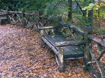 View from Central Park, NewYork. View from Central Park, New York, rustic bench with mold fallen leaves Stock Images