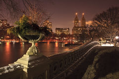 View of Central Park West, the Lake and Bow Bridge. From Bow Bridge in Central Park, New York City, at dusk Royalty Free Stock Image