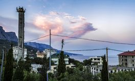 View of the Central part of foros with Central buildings and a tower on the background of the Crimean mountain range 3. View of the Central part of foros with royalty free stock image