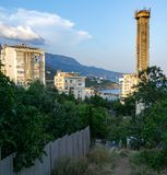 View of the Central part of foros with Central buildings and a tower on the background of the Crimean mountain range. View of the Central part of foros with royalty free stock photos