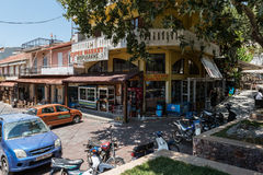 View on central street of Spili town on Crete island, Greece. SPILI, CRETE, GREECE - JULY 2016: View on central street of Spili town on Crete island, Greece Royalty Free Stock Images