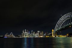View of sydney city harbour in australia at night. View of central sydney city harbour area in australia at night Royalty Free Stock Images
