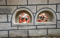 View of Cesky Krumlov through castle wall window. Czech Republic stock photography