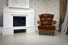 View of chair and fireplace Royalty Free Stock Images