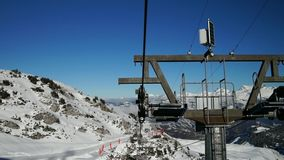 View from the chair lift to the high point on ski resort, sunny day stock video footage