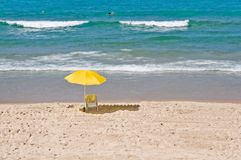 View of  chair and umbrella on the beach . Royalty Free Stock Photos
