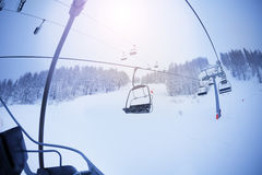 View from the chairlift on snowcapped slopes Royalty Free Stock Image