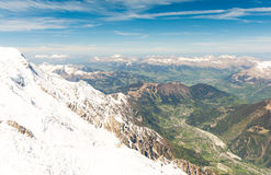 View in Chamonix valley from Aiguille du Midi - Mont Blanc mountain, France Royalty Free Stock Photos