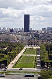 View on the Champ de Mars. The Champ de Mars is a large public green-space in Paris, France, located in the 7th arrondissement, between the Eiffel Tower to the Stock Image