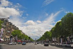 View of Champs-Elysees boulevard in Paris. Paris, France - June 29, 2014. View of Champs-Elysees boulevard in Paris, with historic buildings, street traffic stock photo