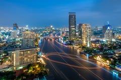 View of Chao Phraya river at night. BANGKOK, THAILAND - OCTOBER 28: Blurred motion of running boats creates lines along Chao Phraya river on October 28, 2012 in Royalty Free Stock Image