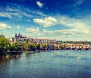 View of Charles bridge over Vltava river and Gradchany (Prague C. Vintage retro hipster style travel image of  Vltava river and Gradchany (Prague Castle) and St Stock Images