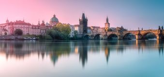 View of Charles bridge Prague, Czech Republic. Morning view of Charles bridge and Prague cityscape with sunbeams, Czech Republic. Travel concept background royalty free stock image