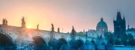 View of Charles bridge Prague, Czech Republic. Morning view of Charles bridge and Prague cityscape with sunbeams, Czech Republic. Travel concept background royalty free stock photography