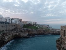 View of the charming seaside town of Polignano a Mare, Southern Italy. View of the charming seaside town of Polignano a Mare and its whitewashed buildings royalty free stock photo