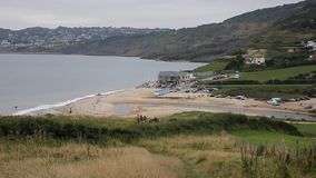 View of Charmouth Dorset England UK and coast. View of Charmouth beach and coast Dorset England UK from the hillside stock video footage