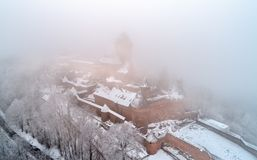 View of the Chateau du Haut-Koenigsbourg in fog. Alsace, France. Winter view of the Chateau du Haut-Koenigsbourg in fog. A major tourist attraction in Alsace Royalty Free Stock Photos