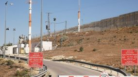 A checkpoint post and sercurity tower on the border between palestine and israel. A view of a checkpoint post and sercurity tower on the border between palestine stock footage
