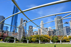 View of Chicago City from Millennium park, Pritzker Pavilion. City buildings and Pritzker Pavilion at Millennium Park in Chicago.  Photo taken in October 5th Royalty Free Stock Photos