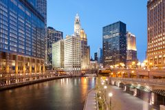 A view of Chicago River, riverwalk and office buildings at downtown. Royalty Free Stock Photo