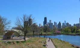 View of Chicago Skyline from Lincoln Park, with South Pond Pavilion. The Chicago Skyline is seen from the bridge at Lincoln Park Zoo. On the left is the South Royalty Free Stock Photography