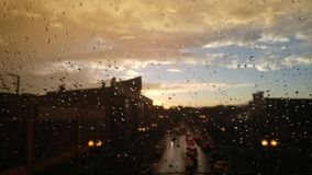 Rainy sunset mood. A view of a Chicago sunset from the subway on a rainy day stock image