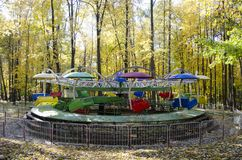 Children carousel in autumn park stock photo