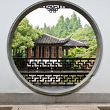 The view  in a chinese traditional garden. The view through a round gateway in a chinese traditional garden Royalty Free Stock Photography