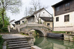 The view  in a Chinese traditional village. A good view in a Chinese  traditional village with small river and old stone bridge Royalty Free Stock Image